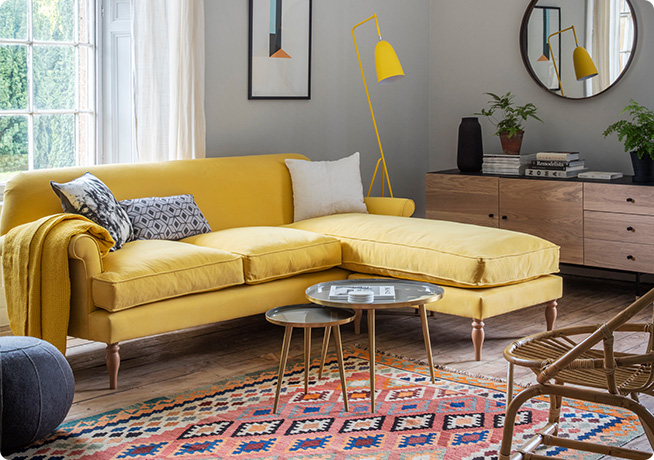 Lifestyle product image of Peter Chaise in yellow fabric and the Nima rug by Perch & Parrow