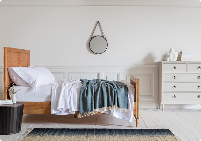 Hygge lifstyle bedroom interior image of the Aristotle Bed in Weather Wood and Daphne Throw in Blue by Perch & Parrow