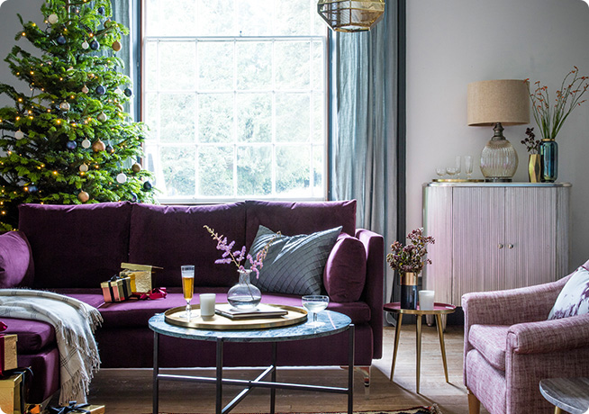 Christmas lifestyle image with paul chaise in velvet purple and jay silver drinks cabinet by Perch & Parrow