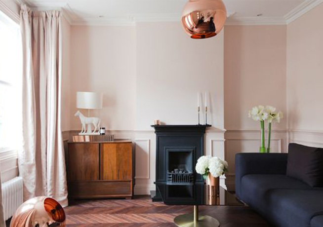 Pink room lifestyle shot of black sofa and fireplace with rose tinted gold lamp by 2 Lovely Gays