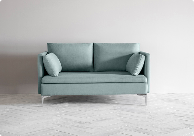 A blue 2-seater sofa, product name Paul, by Perch and Parrow