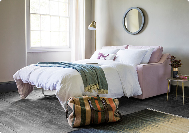 Guest bedroom interior with Lolly 3-Seater Sofa Bed in pink by Perch & Parrow