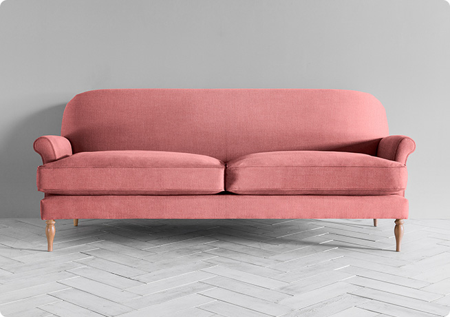 Pink fabric Peter sofa by Perch and Parrow front shot