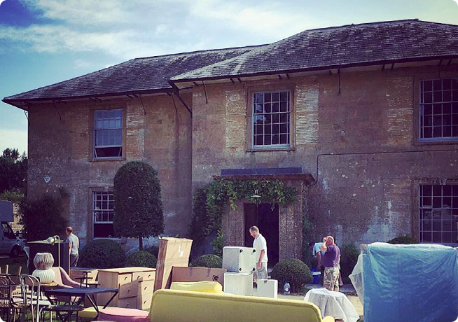 Stone country house photoshoot location with furniture pieces outside