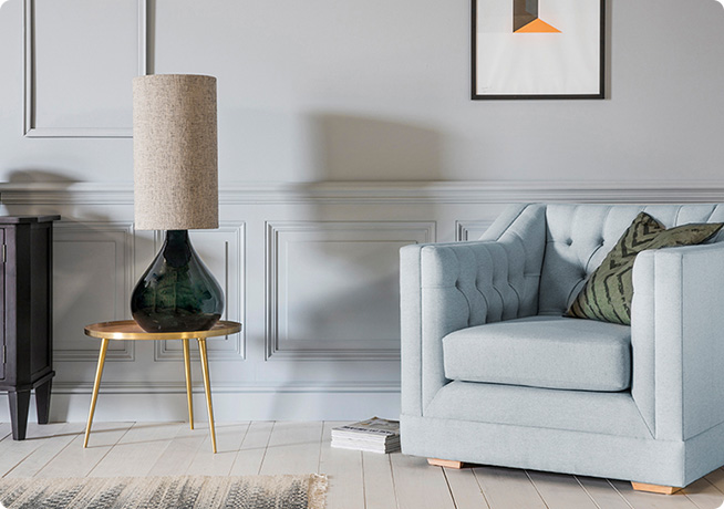 Lifestyle interior of blue James Armchair with Kadence table lamp by Perch and Parrow