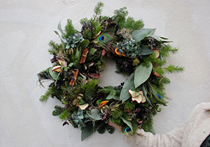 Christmas wreath with peacock feathers by florist Rebel Rebel