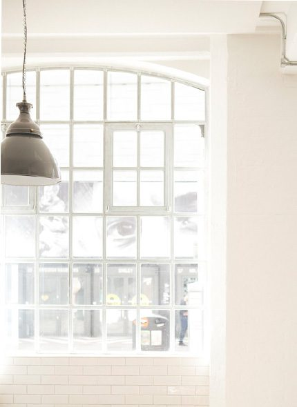 Lyle's white glass window with white pendant light hanging
