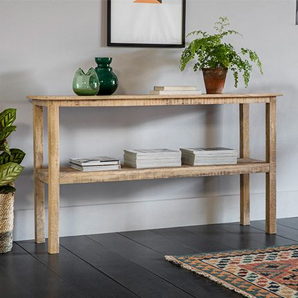 Two shelve wooden Bobo Console by Perch and Parrow with ornaments in a living room setting