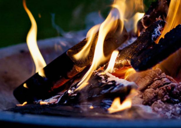 burning open log fire with yellow flames
