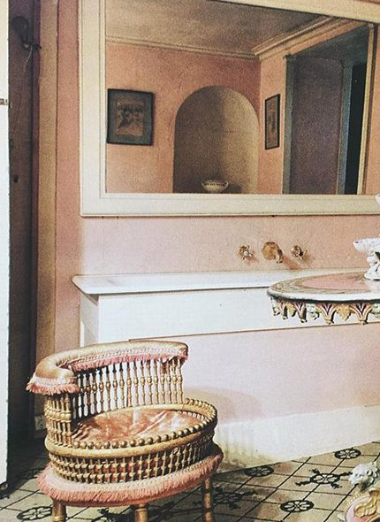 : Madeleine Castaing pink interior with tiled floor and gold and pink chair