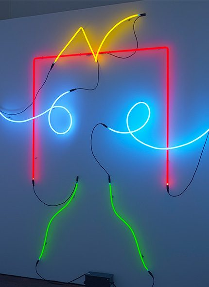 multicoloured neon light sculpture of a human form