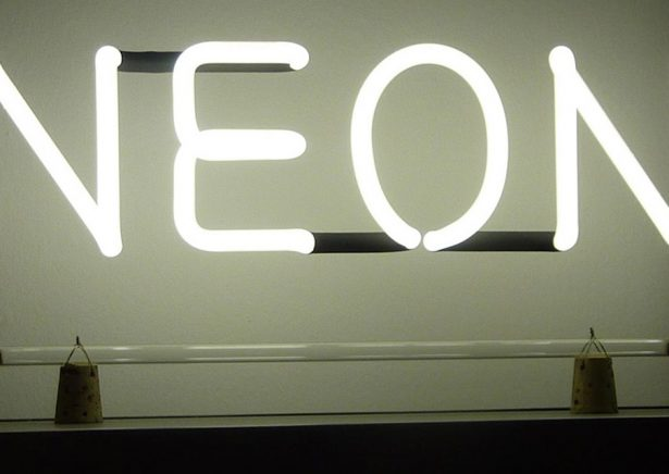 white light text neon sign with black background