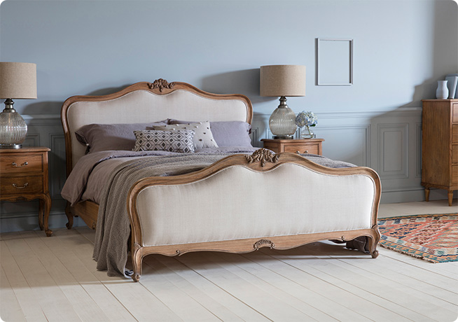 French country style Opera double bed in weather wood and cream cushion panels in a bedroom interior image by Perch & Parrow