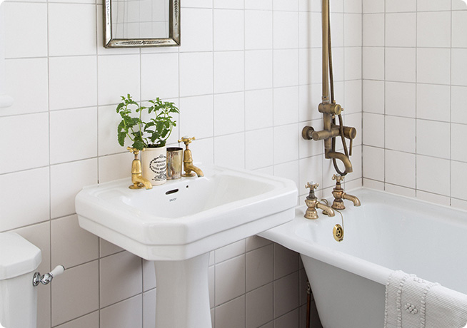 White walled and gold tap filled Bathroom by Ali Brown