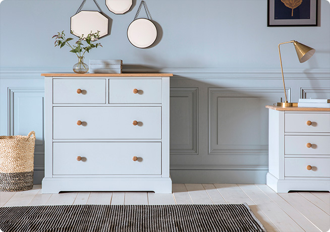 Light blue wooden Hattie chest of drawers and matching bedside table in blue bedroom interior shot by Perch & Parrow