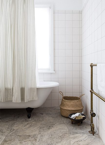 White walled bathroom with bathtub and curtain by Ali Brown