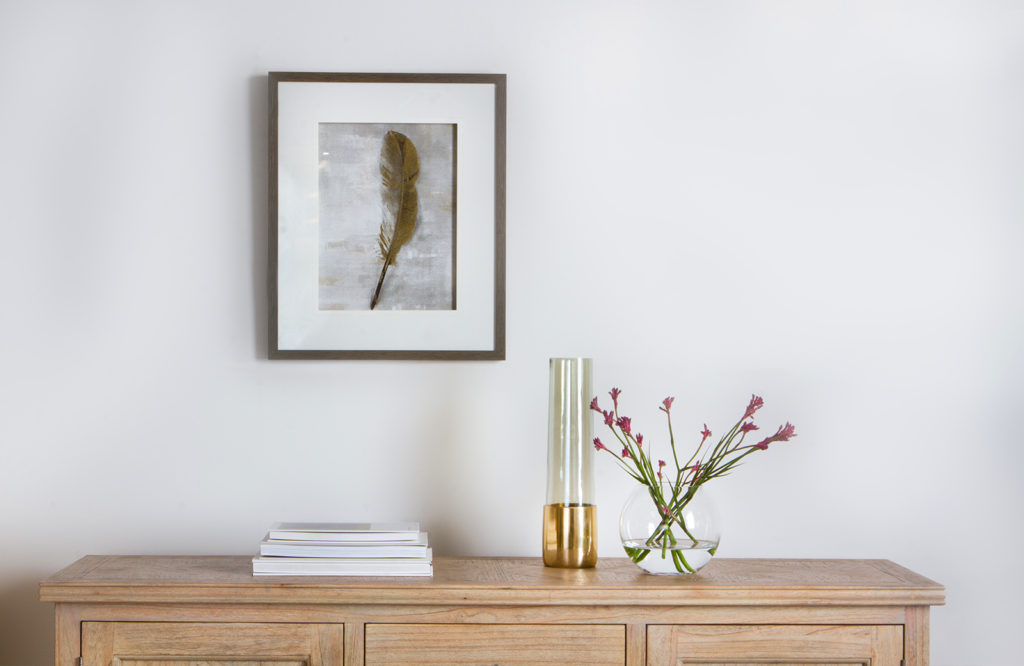 Wall art, such as our Golden Feather, combined with vases like the Jemima give this sideboard a luxe feel.